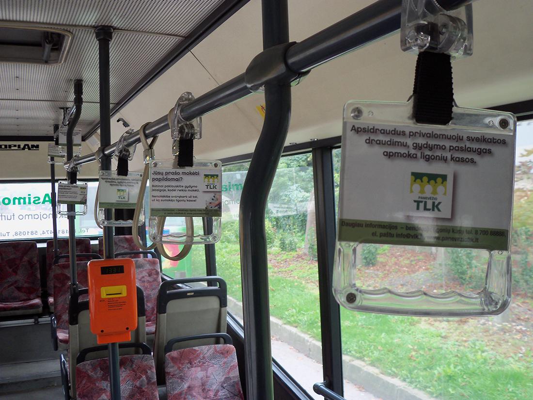 Panevėžio TLK skrajutės autobuso rankenų laikikliuose. (Panevėžio TLK nuotr.)